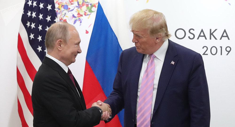 فلاديمير بوتين ودونالد ترامب في قمة العشرين في اليابان