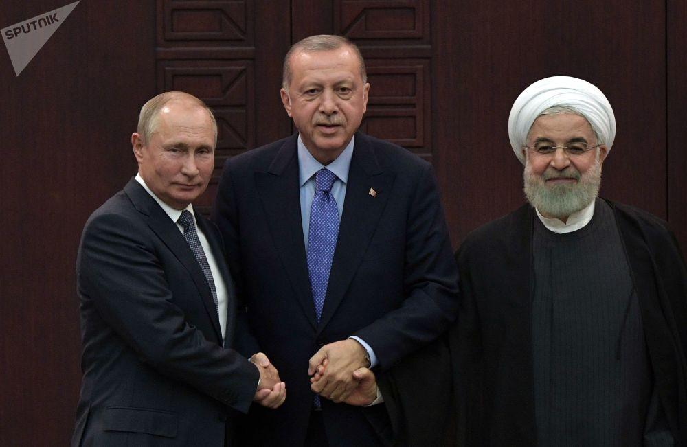 القمة الثلاثية - اجتماع القادة: الرئيس الروسي فلاديمير بوتين والرئيس الإيراني حسن روحاني والرئيس التركي رجب طيب أردوغان في أنقرة، 16 سبتمبر 2019