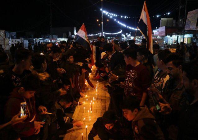 وقفة تضامنية مع ضحايا احتجاجات العراقية، شارع الزهور وسط مدينة تكريت، العراق ديسمبر 2019