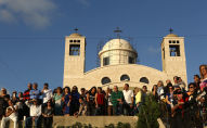 Greek Catholic Christians, also known as Melkite, gather at the Basilica of Our Lady of Mantara in the southern Lebanese town of Maghdouche East of Sidon, on May 29, 2016, during the launching of an event by the Ministry of Tourism to put the Grotto of Maghdouche on the international religious tourism map. - Magdouche, along with Lourdes in France, Fatima in Portugal and Medugorje in Bosnia & Herzegovina are expected to be put on the international religious tourism map. According to local tradition the Virgin Mary accompanied Jesus during his journey to Tyre and to Sidon and waited for him in the grotto at Magdoucheh. The grotto was discovered 400 years ago. (Photo by Patrick BAZ / AFP)