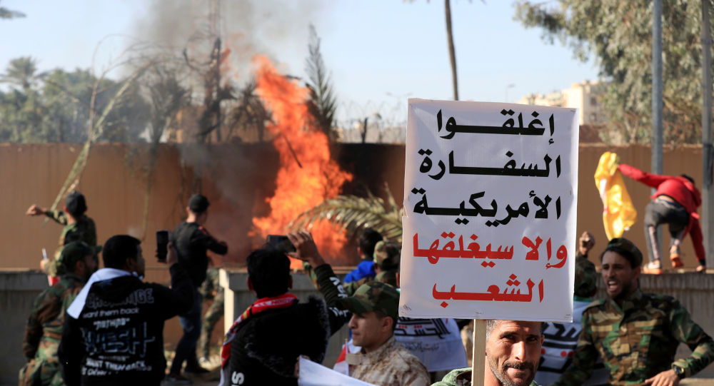 نتيجة بحث الصور عن حرق السفارة الامريكية في بغداد