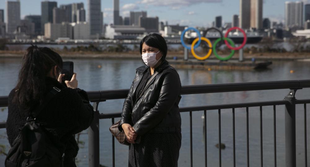 سياح صينيون يرتدون أقنعة واقية طوكيو، اليابان، 29 يناير 2020