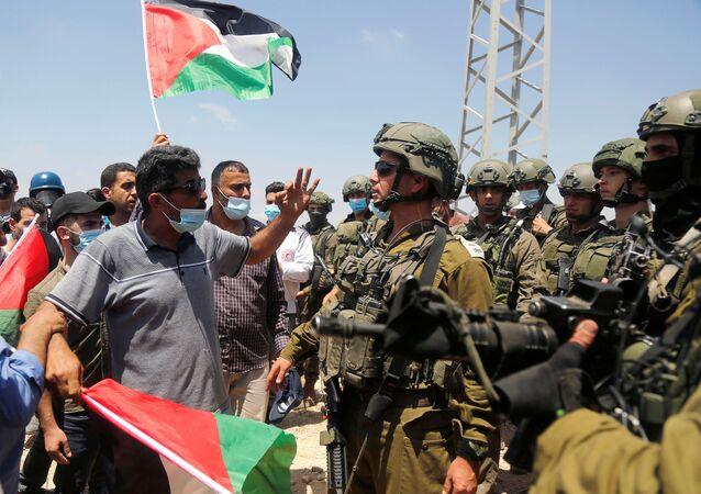 احتجاجات ضد خطة الضم الإسرائيلية لأراضي الضفة الغربية، في بلدة  عصيرة الشماليّة،  يوليو 2020