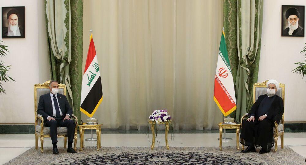 الرئيس الإيراني حسن روحاني ورئيس الوزراء العراقي مصطفى الكاظمي