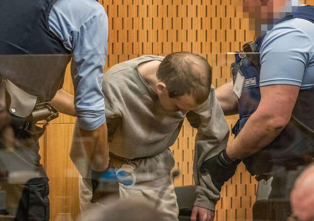 برنتون تارانت المسلح الذي أطلق النار وقتل المصلين في هجمات مسجد كرايستشيرش أثناء إدانته في المحكمة العليا في كرايستشيرش- نيوزيلندا