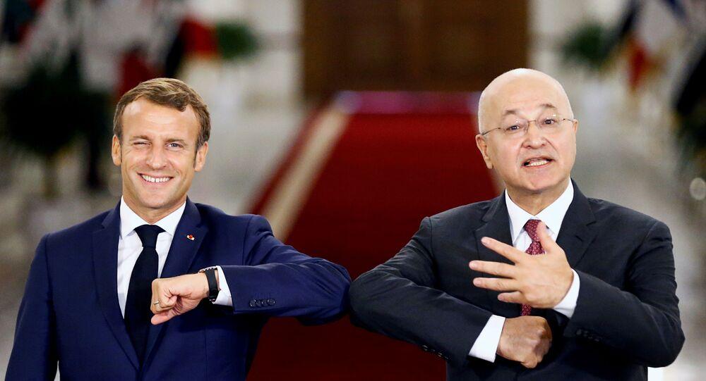 الرئيس العراقي برهم صالح والرئيس الفرنسي إيمانويل ماكرون