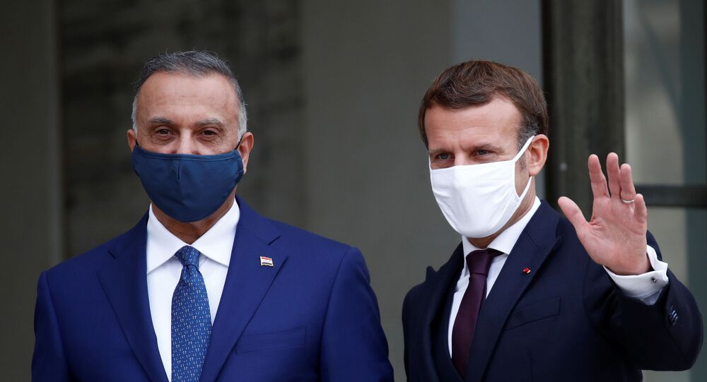 الرئيس الفرنسي إيمانويل ماكرون، يلتقي مع رئيس الوزراء العراقي مصطفى الكاظمي في باريس، فرنسا 19 أكتوبر 2020