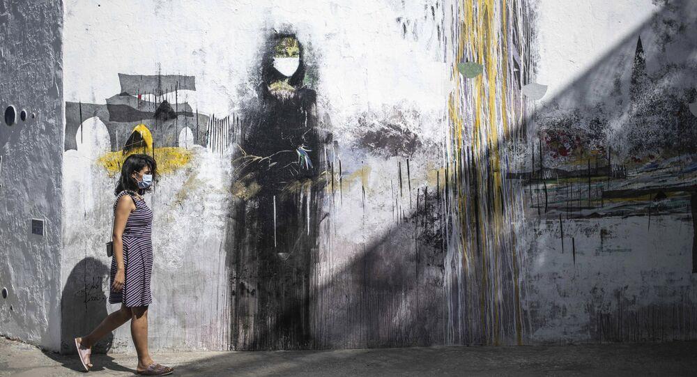 رسم غرافيتي توضيحي للوضع الوبائي في العالم ، فيروس كورونا - أصيلة، المغرب 19سبتمبر 2020
