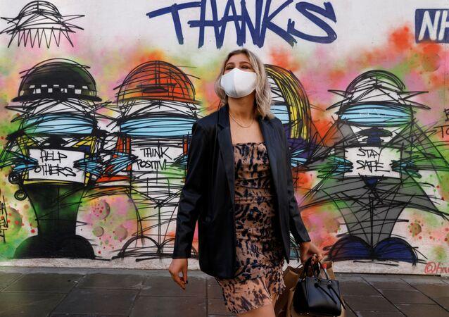رسم غرافيتي توضيحي للوضع الوبائي في العالم ، فيروس كورونا - لندن، بريطانيا 15 أكتوبر 2020