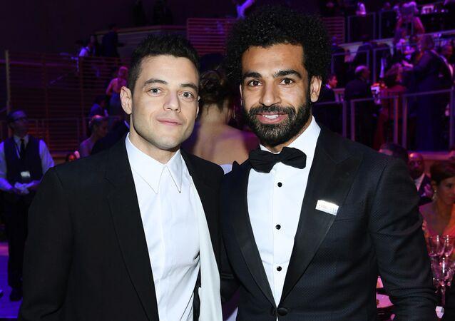 اللاعب الدولي، محمد صلاح، مح الممثل الأمريكي، رامي مالك، في حفل مجلة تايم 100، نيويورك، الولايات المتحدة، 23 نيسان/ أبريل 2019