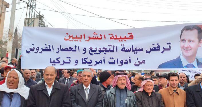 مظاهرات حاشدة رفضا للحصار الذي يضربه مسلحو تنظيم قسد على الأحياء في مدينة الحسكة شمال شرق سوريا، 27 يناير 2021