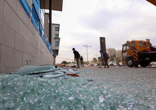 متجر متضرر في أعقاب هجوم صاروخي في أربيل 16 فبراير