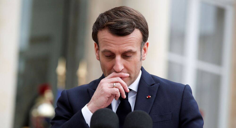 الرئيس الفرنسي إيمانويل ماكرون يعترف بقتل المناضل الجزائري علي بومنجل