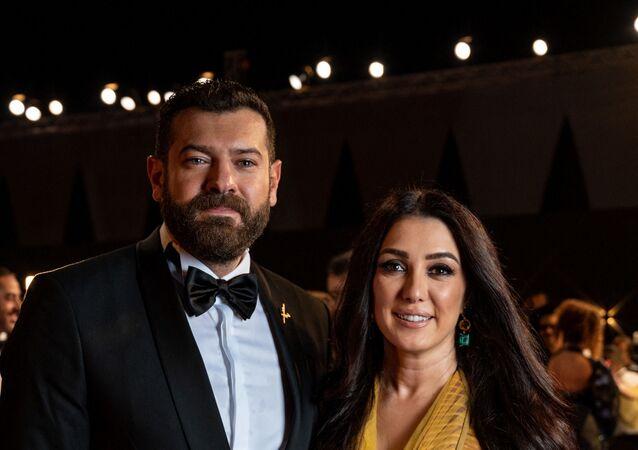 الممثل المصري، عمرو يوسف، وزوجته السورية، كندة علوش