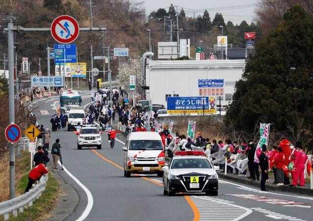 انطلاق مسيرة شعلة الأولمبياد دون احتفالات بسبب كورونا في اليابان، 25 مارس 2021