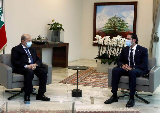 الرئيس اللبناني ميشال عون ورئيس الحكومة المعين سعد الحريري في قصر بعبدا، لبنان 18 مارس 2021