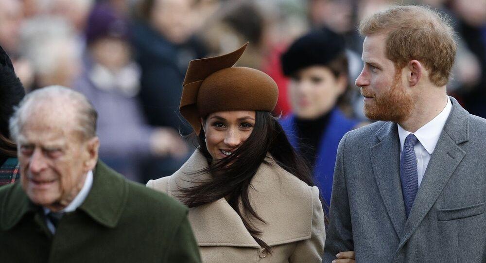 الأمير هاري وميغان ماركل يسيران خلف الأمير فيليب