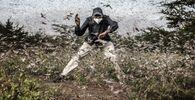 صورة من سلسلة غزو الجراد في شرق أفريقيا، للمصور الإسباني لويس تاتو، الفائزة في فئة الحياة البرية والطبيعة الاحترافية في مسابقة جوائز سوني العالمية للتصوير الفوتوغرافي لعام 2021