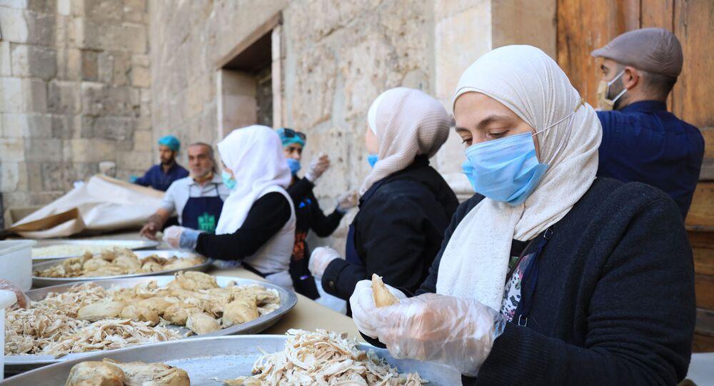 جمعيات مسيحية وإسلامية تقدم سكبة رمضان لصائمي دمشق، سوريا أبريل 2021