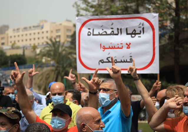 اشتباك أمام عون أمام قصر العدل في بيروت، لبنان