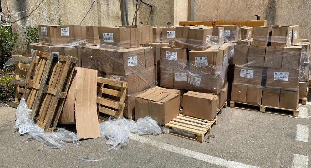 توزيع طرود غذائية على الاسر المحتاجة مقدمة من الصندوق العربي للأنماء