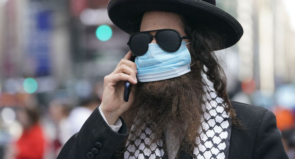 مشاركة اليهود الأرثذوكس (الحاسيديم) في مسيرة تضامنية مع الفلسطينيين في القدس و غزة في نيويورك، الولايات المتحدة 12 مايو 2021