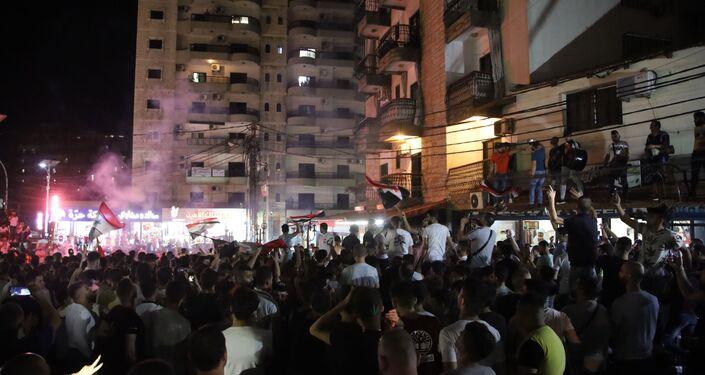 احتفالات في طرابلس بفوز بشار الأسد بالرئاسة