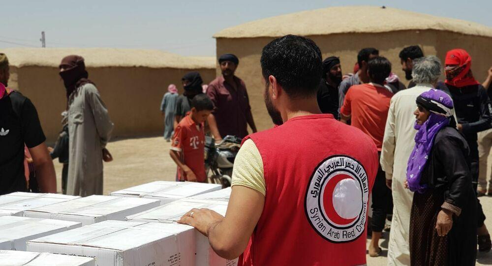 لأول مرة..  (الصليب والهلال) يقدمان مساعدات إغاثية لسكان قرى الحدود (السورية- العراقية)