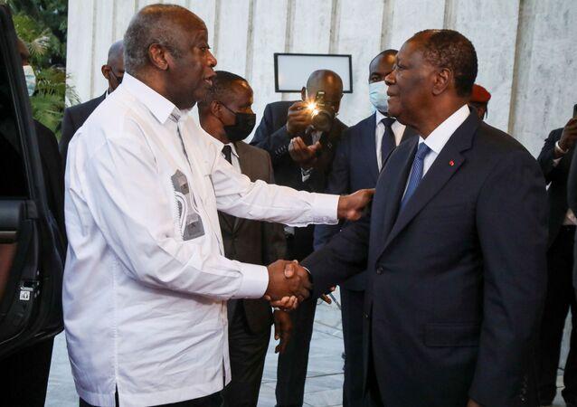 رئيس ساحل العاج واتارا والرئيس السابق غباغبو