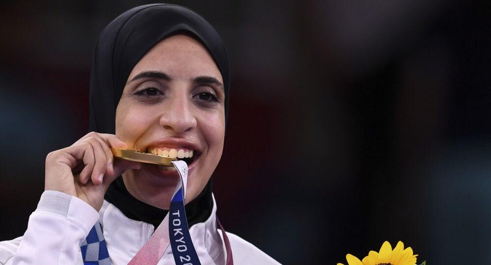 البطلة المصرية فريال أشرف أول فتاة في التاريخ المصري تفوز بميدالية ذهبية في الأولمبياد.