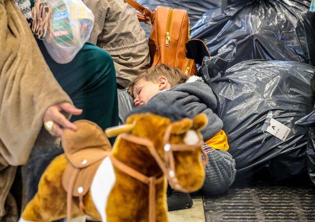 لاجئون أفغانيون في مخيم مؤقت للاجئين من أفغانستان في قاعدة رامشتين الجوية الأمريكية، ألمانيا 26 أغسطس 2021
