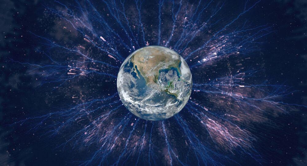 صورة تعبيرية للكرة الأرضية مع الأشعة الكونية حولها