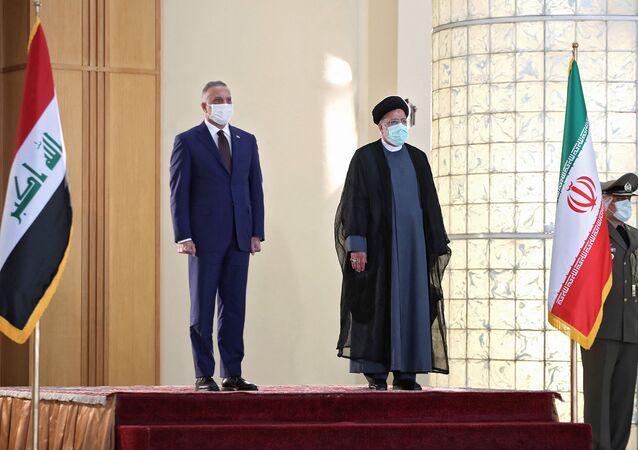 رئيس الوزراء العراقي مصطفى الكاظمي والرئيس الإيراني إبراهيم رئيسي في طهران