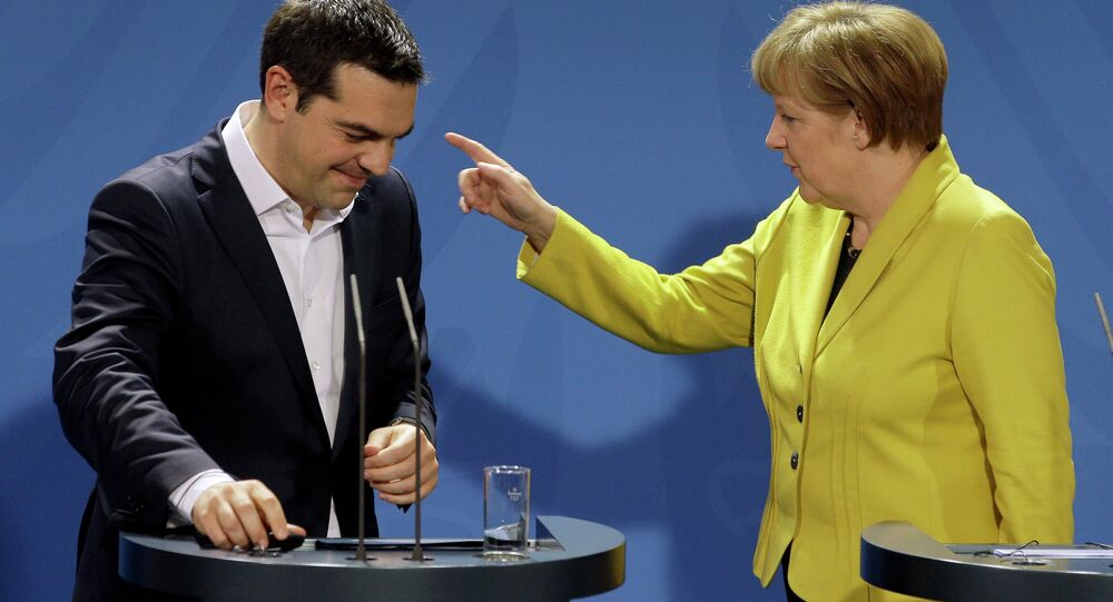 المستشارة الألمانية انجيلا ميركل ورئيس الوزراء اليوناني أليكسيس تسيبراس