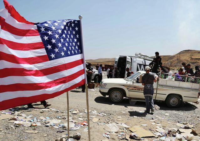 علم الولايات المتحدة على الحدود العراقية السورية