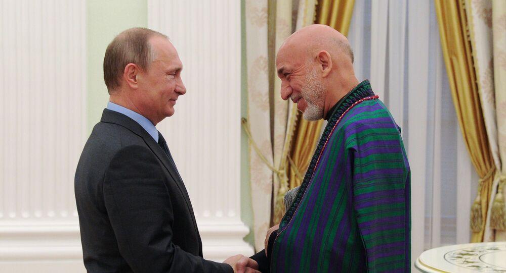 الرئيس الروسي، فلاديمير بوتين و الرئيس الأفغاني السابق، حامد كرزاي