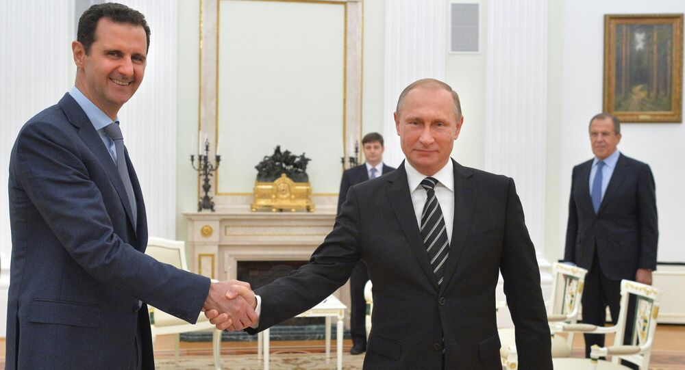 الرئيس الروسي فلاديمير بوتين ونظيره السوري بشار الأسد