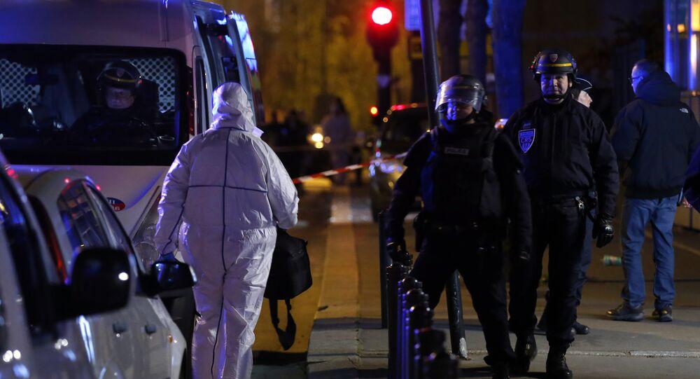 An investigating police officer, left, arrives outside the Stade de France stadium after an international friendly soccer match France against Germany, in Saint Denis, outside Paris, Friday Nov. 13, 2015.