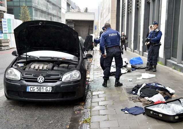 Police officers check a suspected car during an alert in Brussels, Belgium, November 16, 2015, following the deadly attacks in Paris