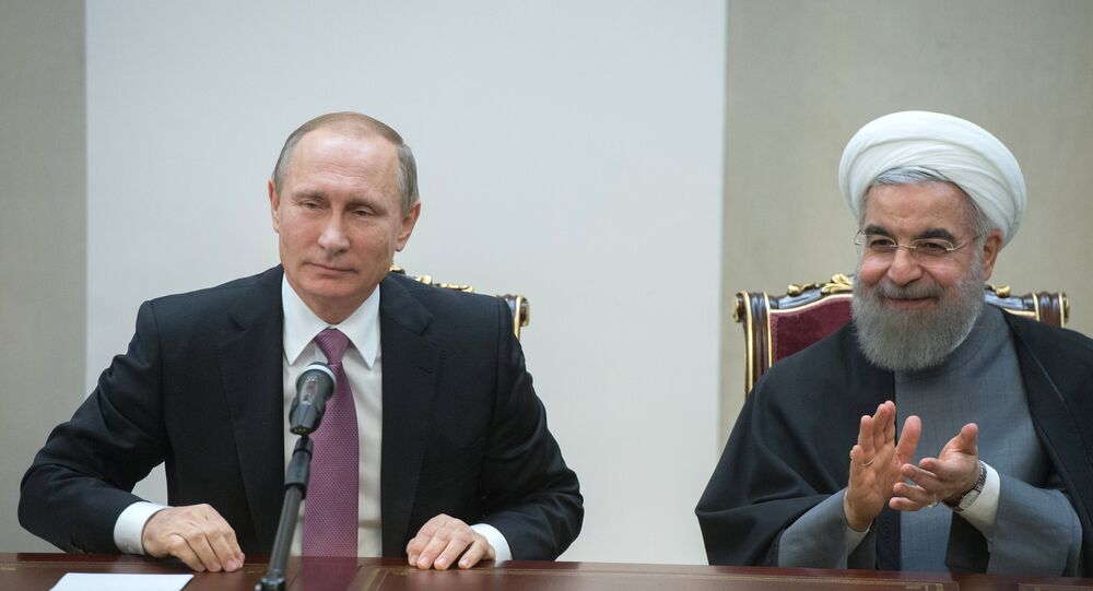 الرئيسان الروسي فلاديمير بوتين والإيراني حسن روحاني