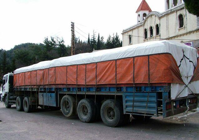 وصول مساعدات روسية إلى مطار حميميم في اللاذقية
