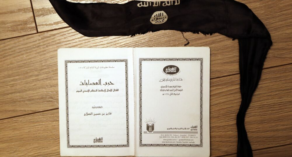 "A suicide bomber's head-band and a manual, entitled ""How to wage an ideal fight against the criminal Assad regime"" found in an office of one of the Daesh jihadists in Shadadi"