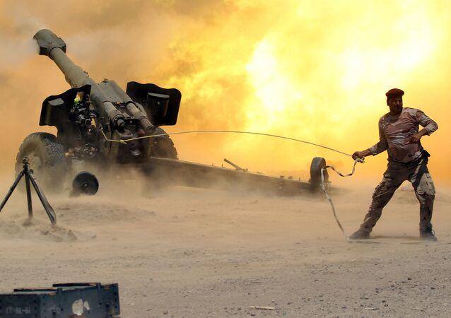 فرد من قوات الأمن العراقية خلال المواجهات مع تنظيم داعش في مدينة الفلوجة، العراق 29 مايو/ آيار 2016.