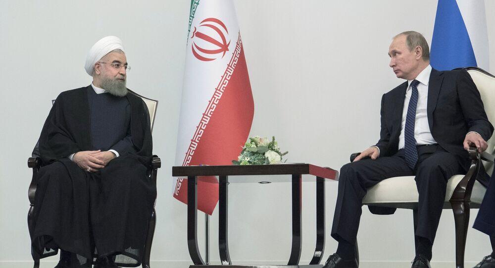 الرئيسين الروسي فلاديمير بوتين والإيراني حسن روحاني