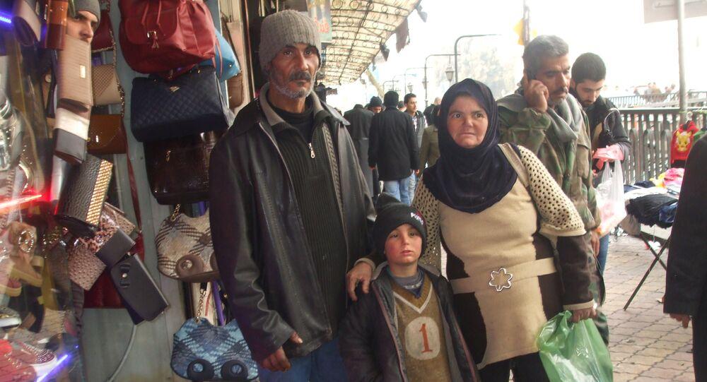 عائلة سورية مهجرة