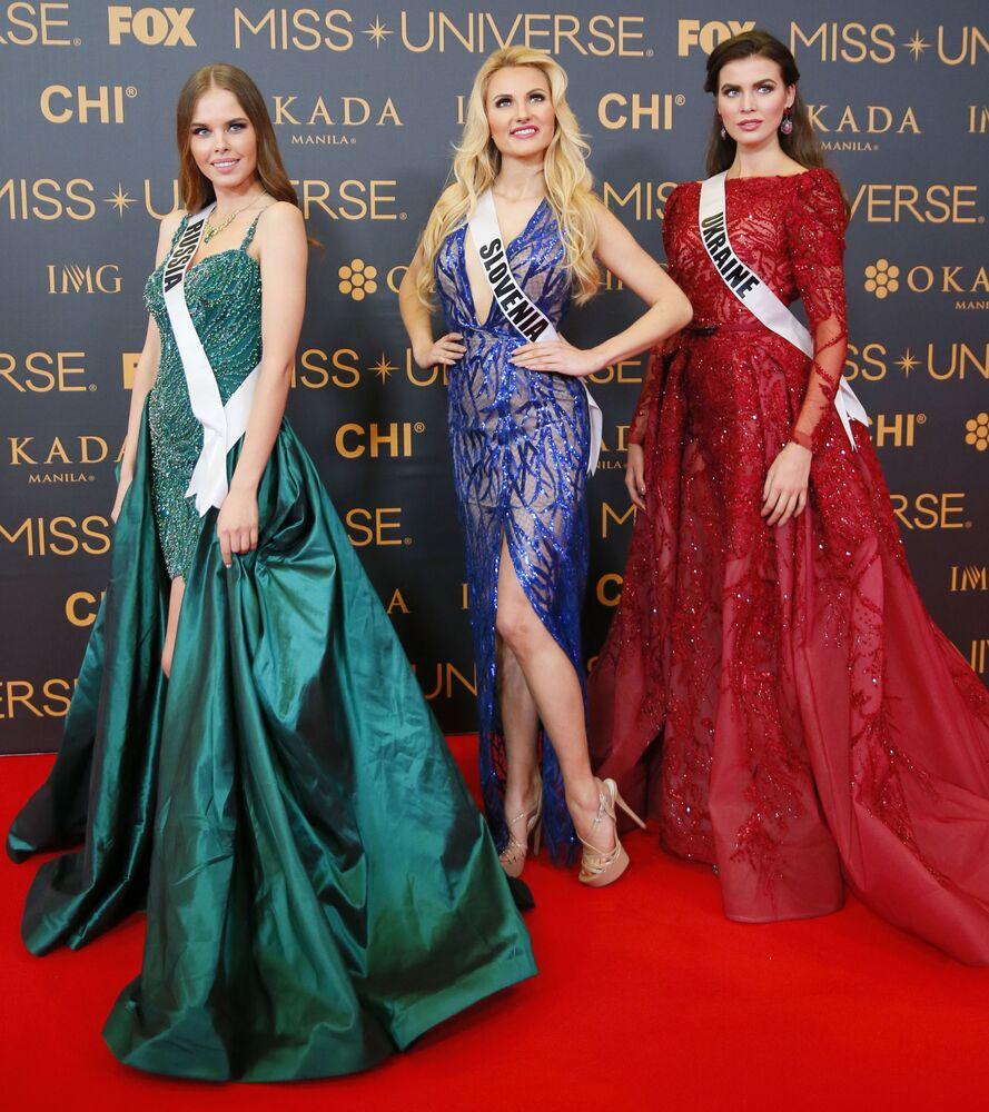المشاركات من أوكرانيا وسلوفينيا وروسيا في مسابقة ملكة جمال الكون على السجادة الحمراء في مانيلا، الفلبين 29 يناير/ كانون الثاني 2017
