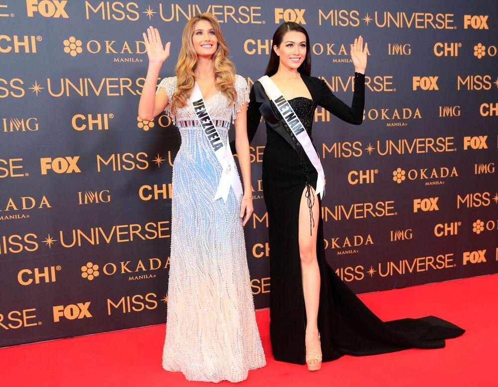 المشاركتان من فييتنام وفينزويلا في مسابقة ملكة جمال الكون على السجادة الحمراء في مانيلا، الفلبين 29 يناير/ كانون الثاني 2017