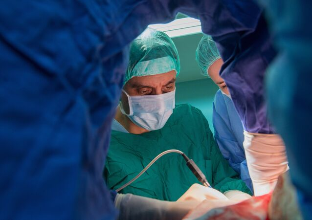Professor Vsevolod Matveyev, Head of the Urology Department at the Russian Ministry of Healthcare Blokhin Russian Oncological Research Center during a surgery. (File)