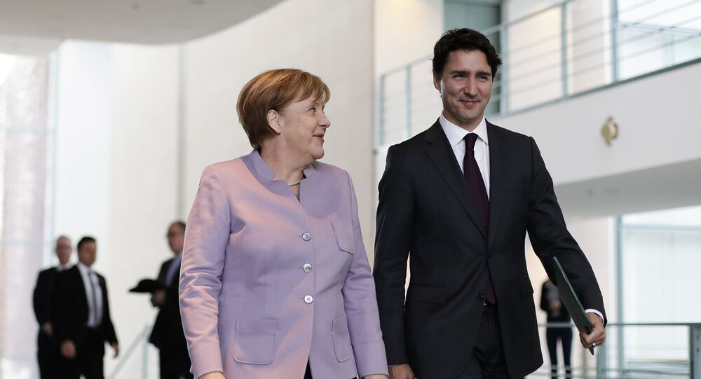 المستشارة الألمانية أنغيلا ميركل مع رئيس وزراء كندا جستن ترودو