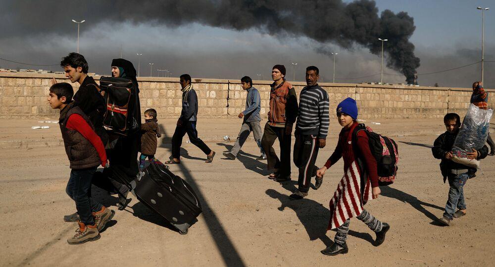 هاربون من جحيم المعارك في الموصل